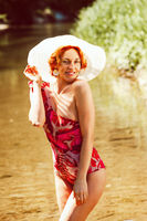 Portrait of a redheaded woman in a swimsuit