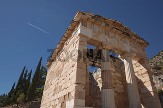The Treasury of Athens or Athenian Treasure in Delphi. Delphi is ancient sanctuary that grew rich as seat of oracle that was consulted on important decisions throughout ancient classical world. UNESCO World heritage