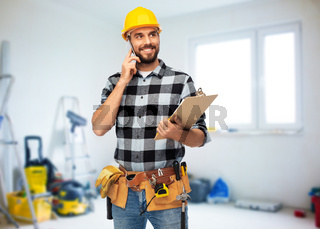 happy builder with clipboard calling on smartphone