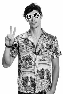 Young handsome man wearing sunglasses with peace sign while giving peace sign gesture