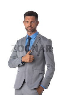 Serious business man with thumb up