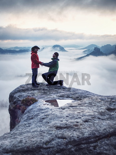 Lover women and men travel together and relax on mountain