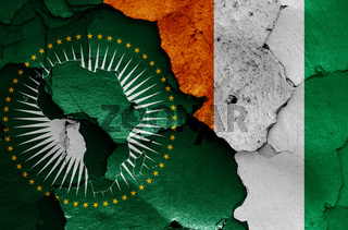 flags of African Union and Ivory Coast painted on cracked wall