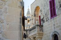 Mdina Cathedral tower viewed from traditional street