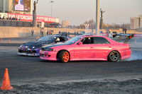 Pink racing car competing on the track T800 with a car near the