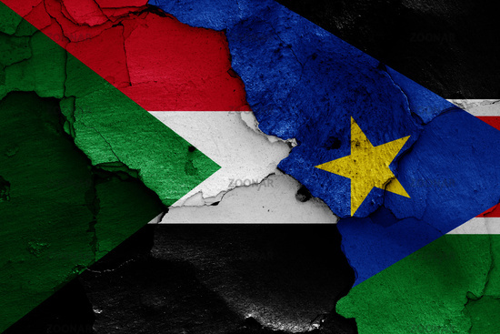 flags of Sudan and South Sudan painted on cracked wall