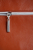 Brown leather with zipper background closeup