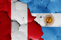flags of Peru and Argentina painted on cracked wall