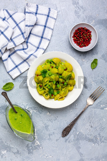Italian pasta with green pea sauce.