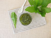 Green herbs pesto with dandelion leaves