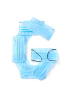 Letter G made from protective medical masks on a white background.