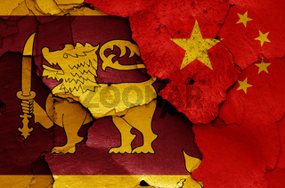 flags of Sri Lanka and China painted on cracked wall