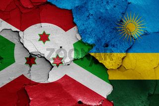 flags of Burundi and Rwanda painted on cracked wall