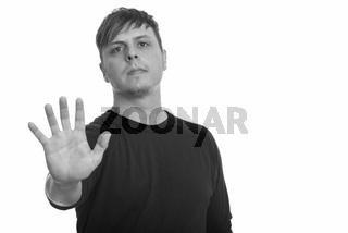 Studio shot of Caucasian man with stop hand gesture