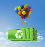 The concept of ecological transportation. Balloons are a freight container on a background of blue sky.
