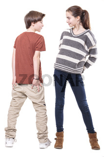 two teenager, male and female smiling at each other, isolated on white