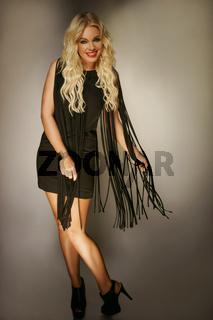 Elegant beautiful blond woman in a black dress