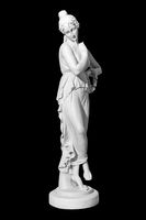 statue of a naked woman on a black background