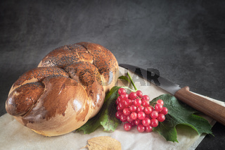 A loaf of white bread and viburnum berries