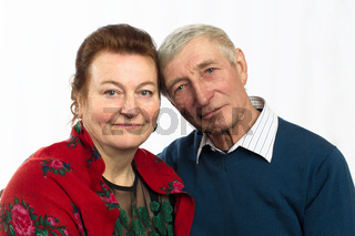 Portrait of an elderly couple. Russian husband and wife.Happy elderly couple embracing