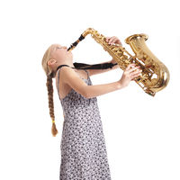 young girl in blue playing saxophone