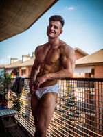 Handsome shirtless muscular young man outdoor on terrace
