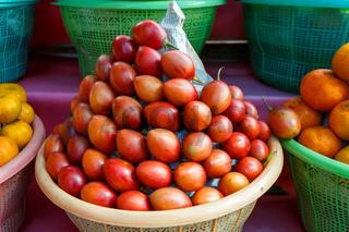 Tamarillo, fruit in plastic basket