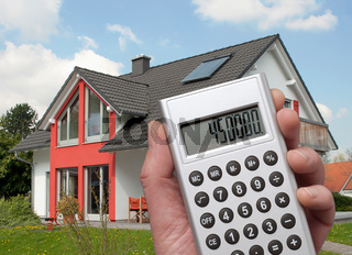 Taschenrechner und Haus