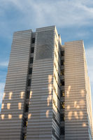 High-rise building with blue sky and features of sunlight