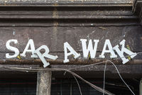 Slipped letters of the lettering Sarawak at a store front