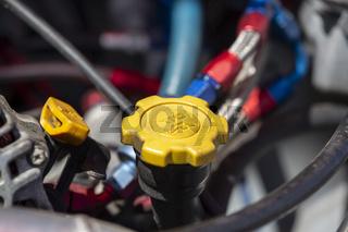 Yellow oil cap of a car
