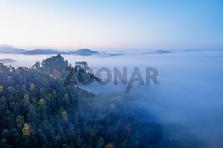 Mountain islands above mist, mountain peak with cabin