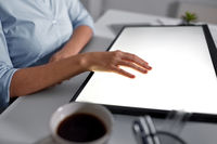 hand on led light tablet at night office