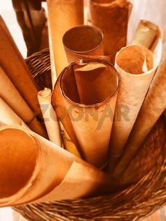 Rolled scrolls in a woven basket