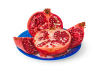 Pomegranate on blue plate