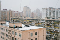 Rooftops and high residential buildings covered by snow in winter
