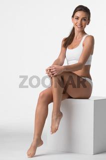 Woman in underwear touch legs