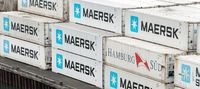 Large group of sea cargo freight containers Maersk and Hamburg Süd stacked on pier in container terminal warehouse commercial sea port in Pacific Ocean