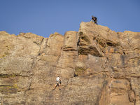 Climbers on a sandstone cliff in northern Colorado