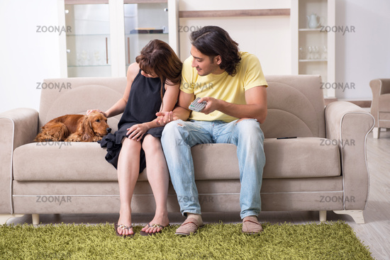 Young couple with cocker spaniel dog