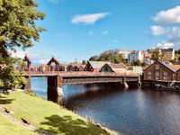 Trondheim's storage houses and the Gamle Bybro bridge on the river Nidelva