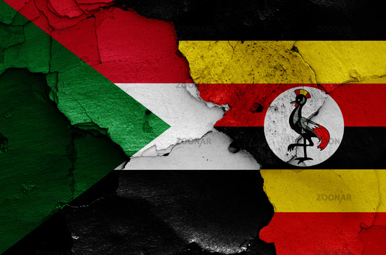flags of Sudan and Uganda painted on cracked wall
