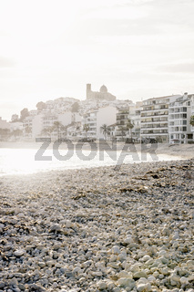 The destroyed beach in Altea after storm Gloria in January 2020 with view on coast and old town with backlight, Altea, Costa Blanca, Spain