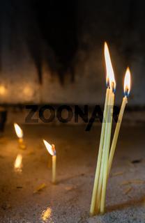 Row of burning memorial candles