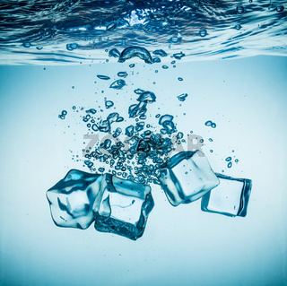 Ice cubes falling under water