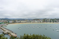 view of the city of San Sebastian, with La Concha beach, from Mount Urgull. Summer vacation scene in Spain
