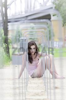 beautiful teenager girl looking through some metal frames