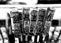 the word MEDIA with old typewriter hammers