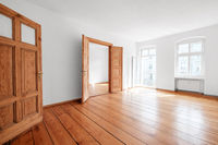 empty living room in apartment flat with wooden floor and balcony