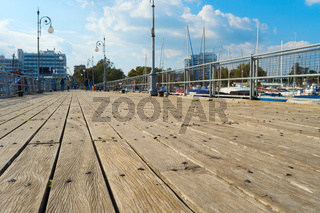 Wooden pier yachts people Cyprus